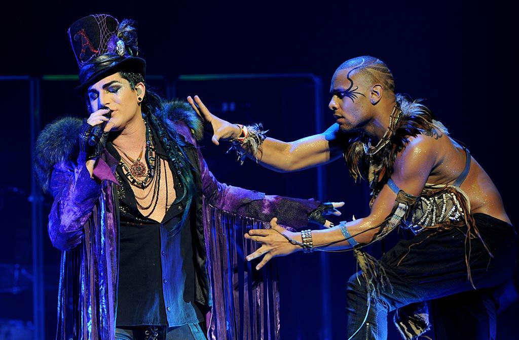 "Back on the West Coast, ""American Idol"" alum Adam Lambert produced a dazzling theatrical display at his ""Glam Nation 2010 Tour"" at Club Nokia in L.A. ""Had an amazing final Glam Nation Show. Thanks to the amazing band, dancers and crew who helped make the past six months a success!"" tweeted Lambert after the show. Kevin Winter/<a href=""http://www.gettyimages.com/"" target=""new"">GettyImages.com</a> - December 16, 2010"