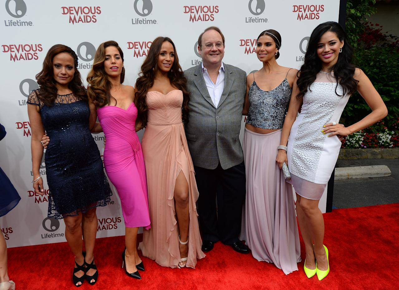 PACIFIC PALISADES, CA - JUNE 17: (L-R) Judy Reyes, Ana Ortiz, Dania Ramirez, Marc Cherry, Roselyn Sanchez and Edy Ganem attend the premiere of Lifetime Original Series 'Devious Maids' at Bel-Air Bay Club on June 17, 2013 in Pacific Palisades, California. (Photo by Mark Davis/Getty Images)