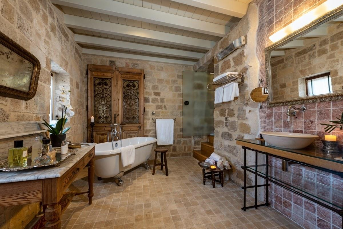 "Dating back to the 15th century (when it was a knight's residence), today the property is a tranquil <a href=""http://www.kokkiniporta.com/"">six-suite hotel inside Rhodes' Old Town walls</a>. Some of the home's bones remain, including stone walls and arched entryways; the house is otherwise decorated with antique wood carvings, Byzantine artifacts, framed tapestries and maps, all of which come together to make it at once cozy and awe-inspiring."