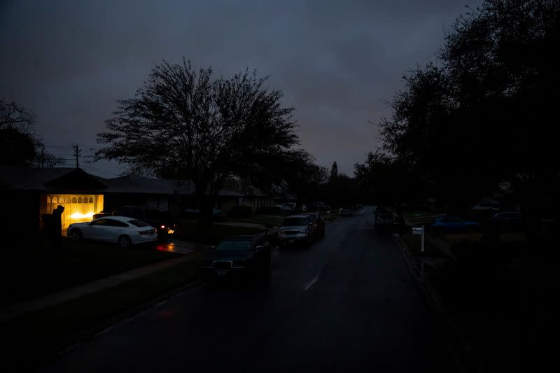 FILE PHOTO: A car idles in a driveway on Jordan Drive, a street with no power in the early morning in Corpus Christi