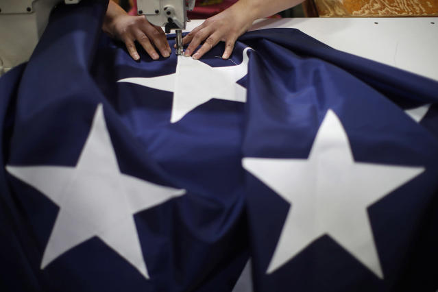 <p>A worker sews a star on to an American flag at the FlagSource facility in Batavia, Illinois, U.S., on Tuesday, June 27, 2017. (Photo: Jim Young/Bloomberg via Getty Images) </p>