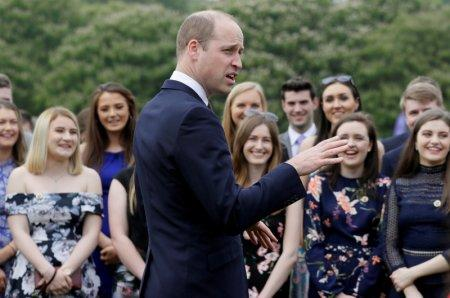 Britain's Prince William talks to award recipients during a day of DofE presentations at Buckingham Palace in London, Britain May 24, 2018. Kirsty Wigglesworth/Pool via REUTERS