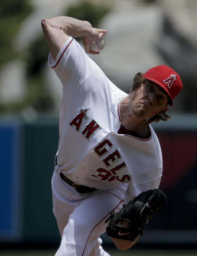 Los Angeles Angels starting pitcher Jered Weaver throws to the Minnesota Twins during the first inning of a baseball game in Anaheim, Calif., Thursday, June 26, 2014. (AP Photo/Chris Carlson)