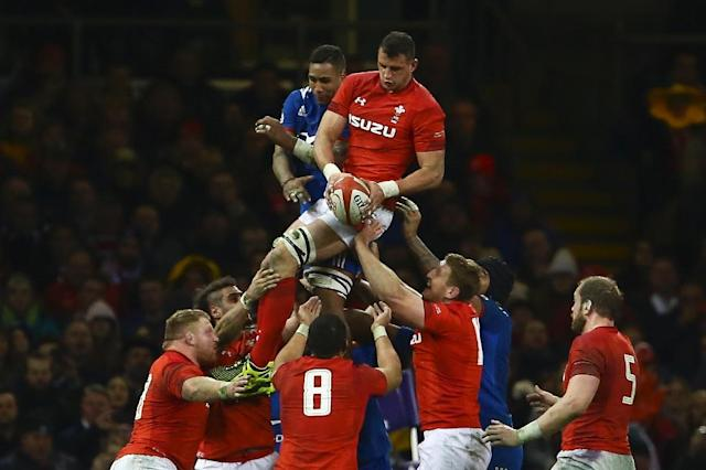 High life: Wales' Aaron Shingler wins lineout ball (AFP Photo/Geoff CADDICK)