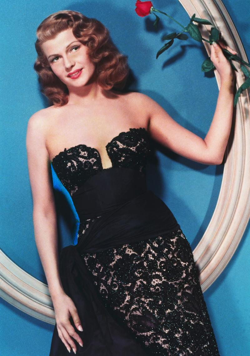 Hayworth wears a lace dress in this undated photo.