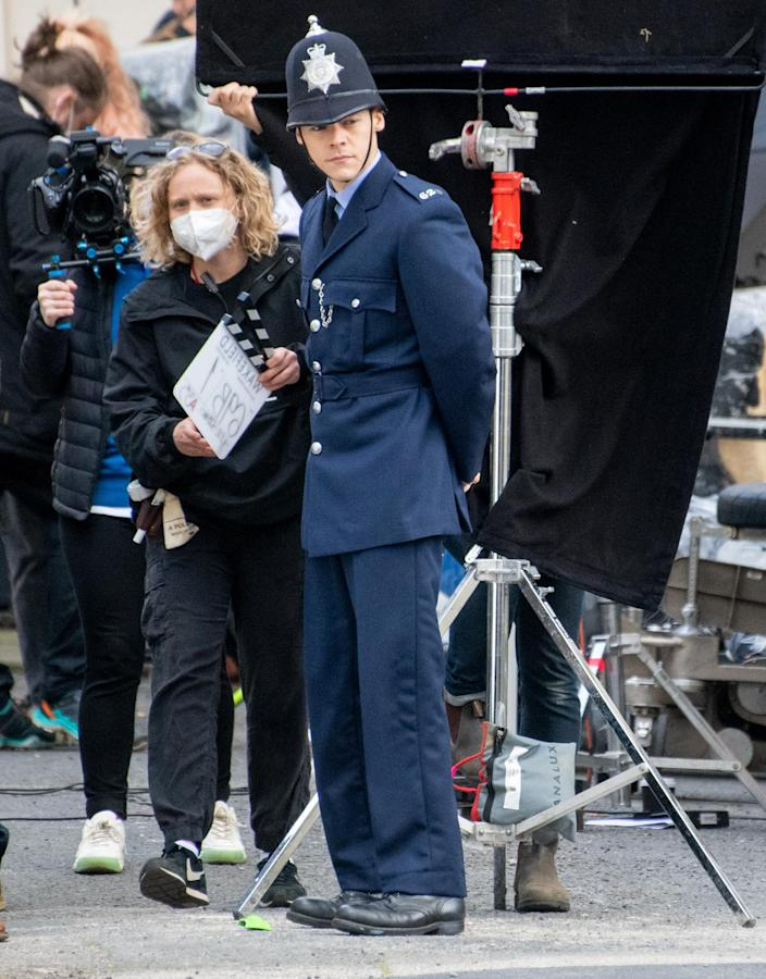 <p>Harry Styles is seen in character shooting scenes for his new film <em>My Policeman</em> in Brighton on Tuesday in the U.K.</p>