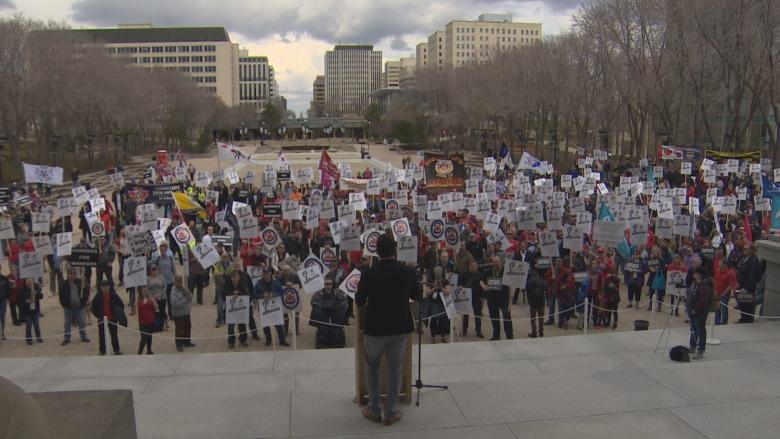 Union members rally at the Alberta legislature for stricter labour laws
