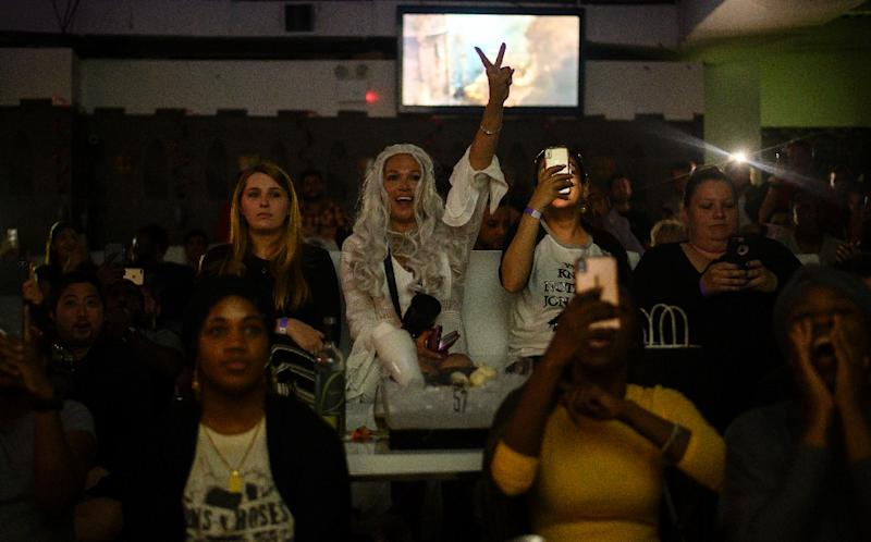 """A fan dressed as Daenerys Targaryen awaits the """"Game of Thrones"""" finale at a viewing party in New York City (AFP Photo/Johannes EISELE)"""