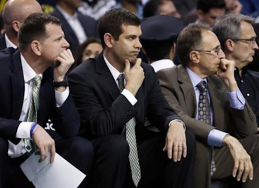 Boston Celtics head coach Brad Stevens, middle, watches from the bench in the second half of an NBA basketball game against the Golden State Warriors in Boston, Wednesday, March 5, 2014. The Warriors won 108-88. (AP Photo/Elise Amendola)