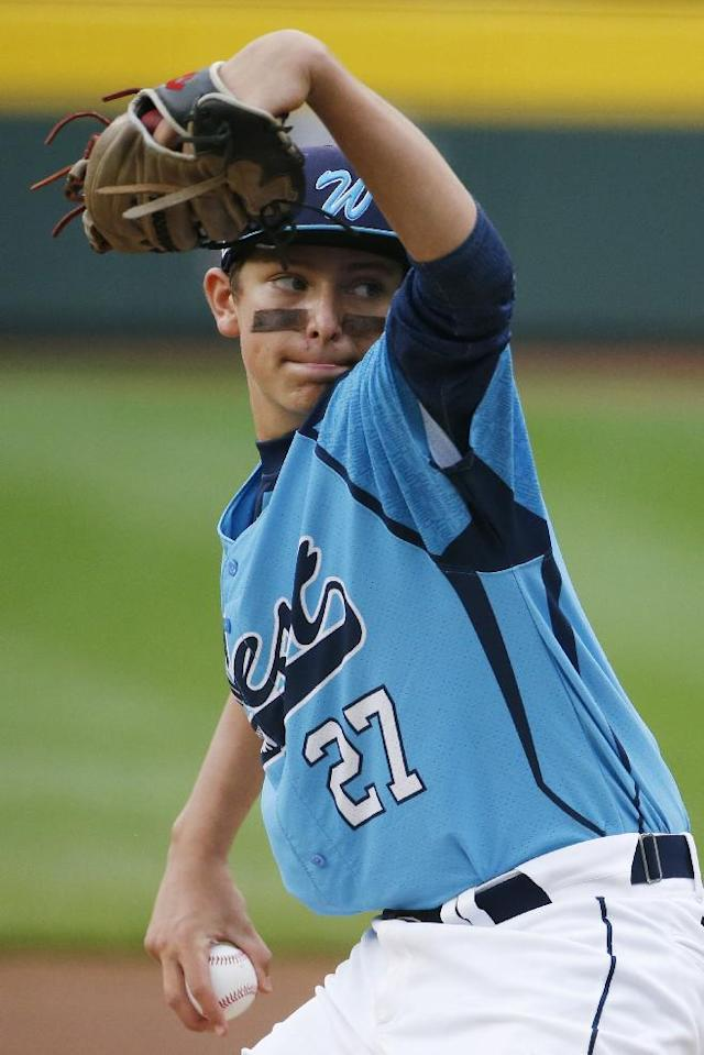 Las Vegas' Brennan Holligan (27) delivers against Chicago in the first inning of the United States Championship game against Chicago at the Little League World Series tournament in South Williamsport, Pa., Saturday, Aug. 23, 2014. (AP Photo/Gene J. Puskar)
