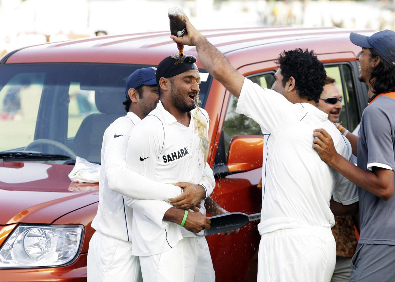 KANPUR, INDIA - APRIL 13:  Harbhajan Singh of  India celebrates with his team mates after being awarded with Man of the Series Trophy (car) on day three of the Third Test match between India and South Africa at Green Park Stadium on April 13, 2008 in Kanpur, India. (Photo by Duif du Toit/Gallo Images/Getty Images)