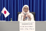 In this image made from a video, Sarah AlAmeeri of United Arab Emirates' Ministry of Advanced Technology attends a news conference at Tanegashima Space Center on a small southern Japanese island after a launch of a United Arab Emirates spacecraft Monday, July 20, 2020. A United Arab Emirates spacecraft rocketed away Monday on a seven-month journey to Mars, kicking off the Arab world's first interplanetary mission. (MHI via AP Photo)