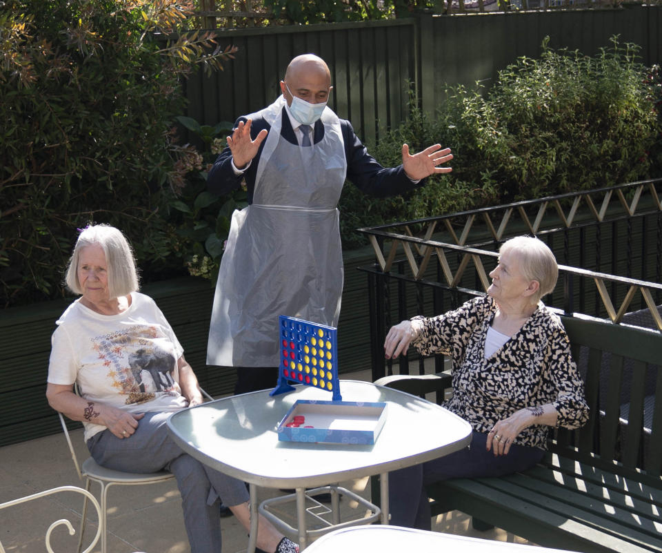Britain's Health Secretary Sajid Javid, centre, talks to residents Doreen, left and Janet, during a visit to Westport Care Home in Stepney Green, east London, Tuesday, Sept. 7, 2021, ahead of Boris Johnson unveiling his long-awaited plan to fix the broken social care system. (Paul Edwards/Pool Photo via AP)
