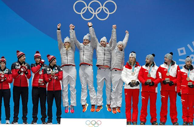 Medals Ceremony - Luge - Pyeongchang 2018 Winter Olympic Games - Team Relay - Medals Plaza - Pyeongchang, South Korea - February 16, 2018 - Gold medalists Natalie Geisenberger, Johannes Ludwig, Tobias Wendl and Tobias Arlt of Germany, silver medalists Alex Gough, Sam Edney, Tristan Walker and Justin Snith of Canada, bronze medalists Madeleine Egle, David Gleirscher, Peter Penz and Georg Fischler of Austria on the podium. REUTERS/Eric Gaillard TPX IMAGES OF THE DAY