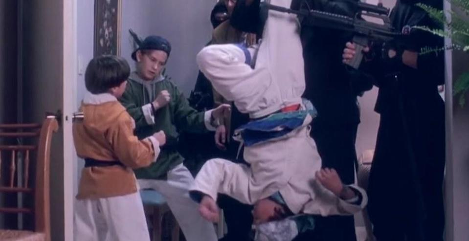 The 3 ninjas fight against bad guys dressed in black in their house