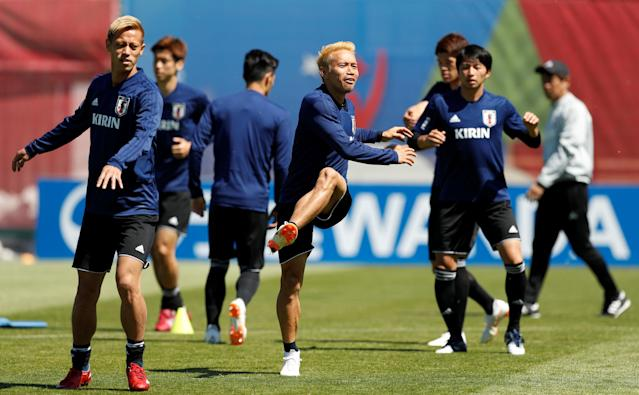 Soccer Football - World Cup - Japan Training - Japan Training Camp, Kazan, Russia - June 17, 2018 Japan's Keisuke Honda and Yuto Nagatomo with team mates during training REUTERS/John Sibley