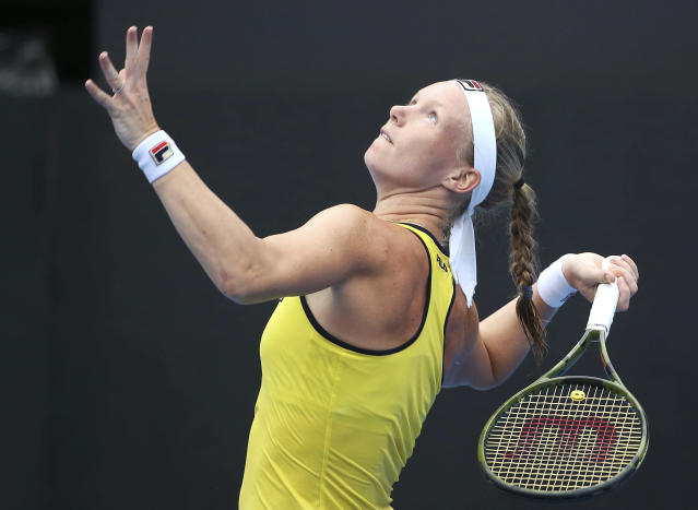Kiki Bertens of the Netherlands prepares to serve to Ash Barty of Australia during their women's singles semifinal match at the Sydney International tennis tournament in Sydney, Friday, Jan. 11, 2019. (AP Photo/Rick Rycroft)