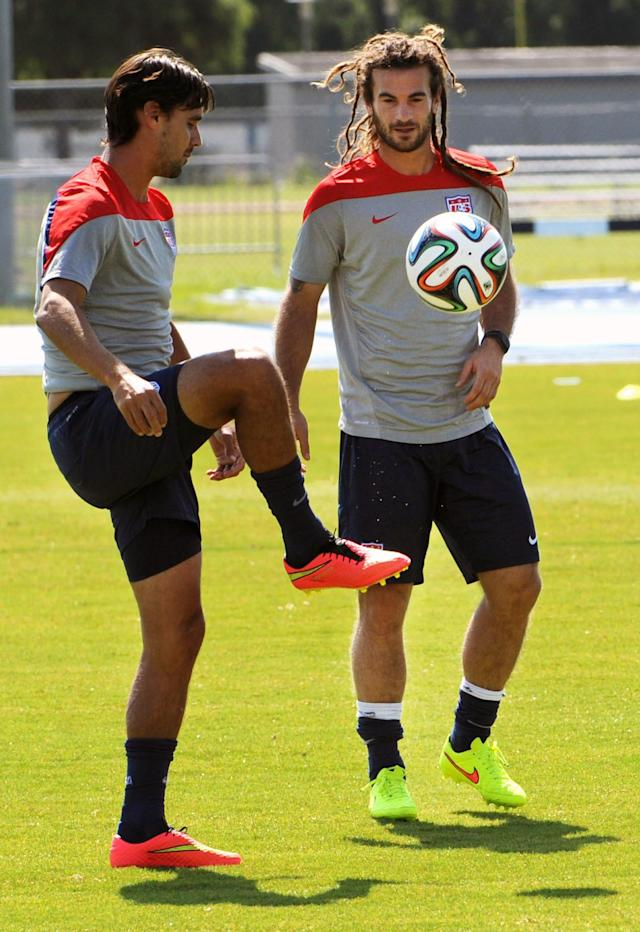 Chris Wondolowski, left, and Kyle Beckerman kick the ball around before practice starts Wednesday, June 4, 2014 in Jacksonville, Fla.. The U.S. soccer team was practicing in advance of Saturday's friendly match against Nigeria, the last before the World Cup matches in Brazil. (AP Photo/The Florida Times-Union, Bob Mack)