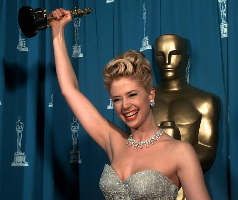Mira Sorvino celebrates after winning the Oscar for Best Performance by an Actress in a Supporting Role for 'Mighty Aphrodite in 1996. (AP Photo/Reed Saxon)