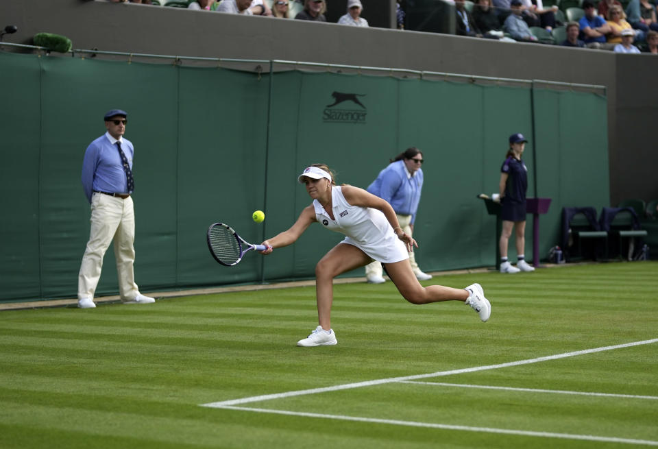 Sofia Kenin of the US returns the ball to China's Xiyu Wang during the women's singles match on day one of the Wimbledon Tennis Championships in London, Monday June 28, 2021. (AP Photo/Alberto Pezzali)