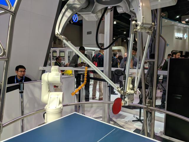 Japanese firm Omron's robot arms can play table tennis.