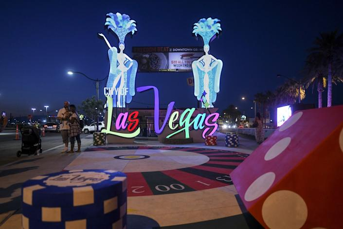 The Las Vegas gateway sign features showgirls and dice.