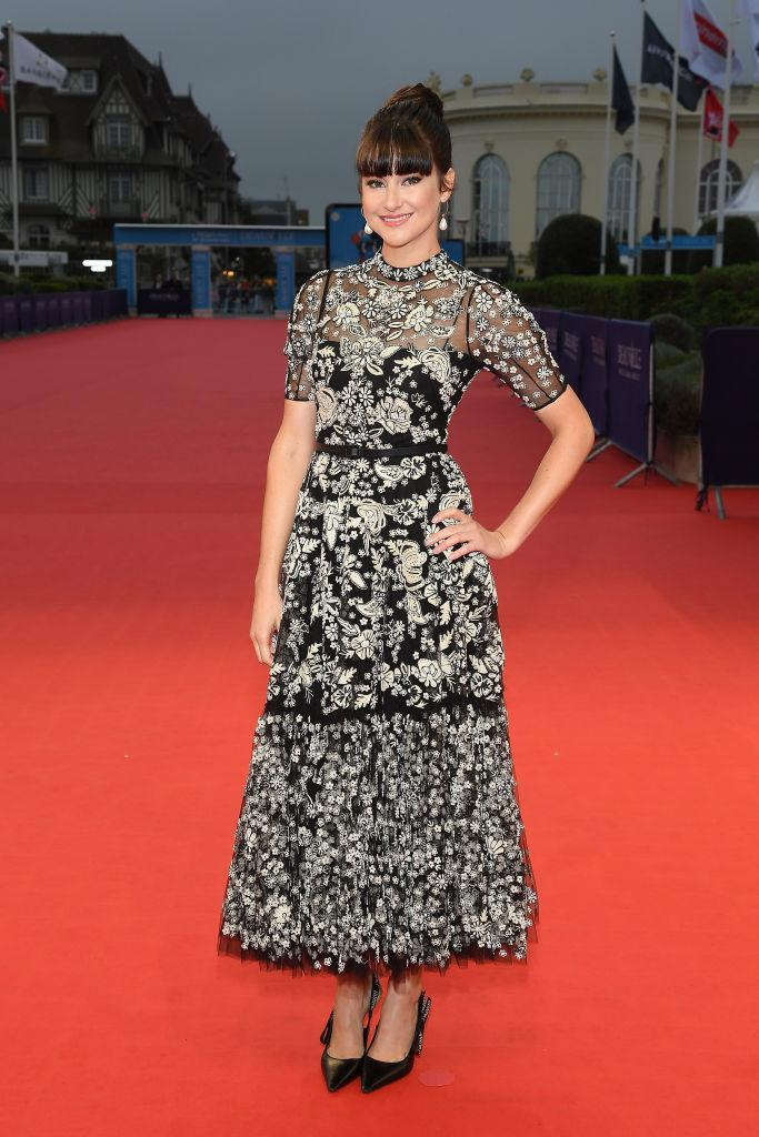 <p>On September 5, actress Shailene Woodley chose a Christian Dior dress for a film festival in France. She finished the red carpet look with a chic topknot and monochrome accessories. <em>[Photo: Getty]</em> </p>