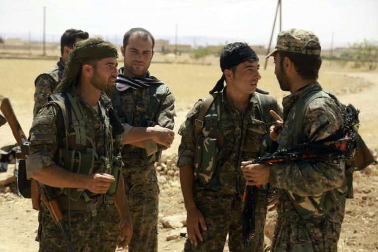 Fighters from the Syrian Democratic Forces (SDF) gather on the outskirts of the northern Syrian town of Manbij, on June 10, 2016