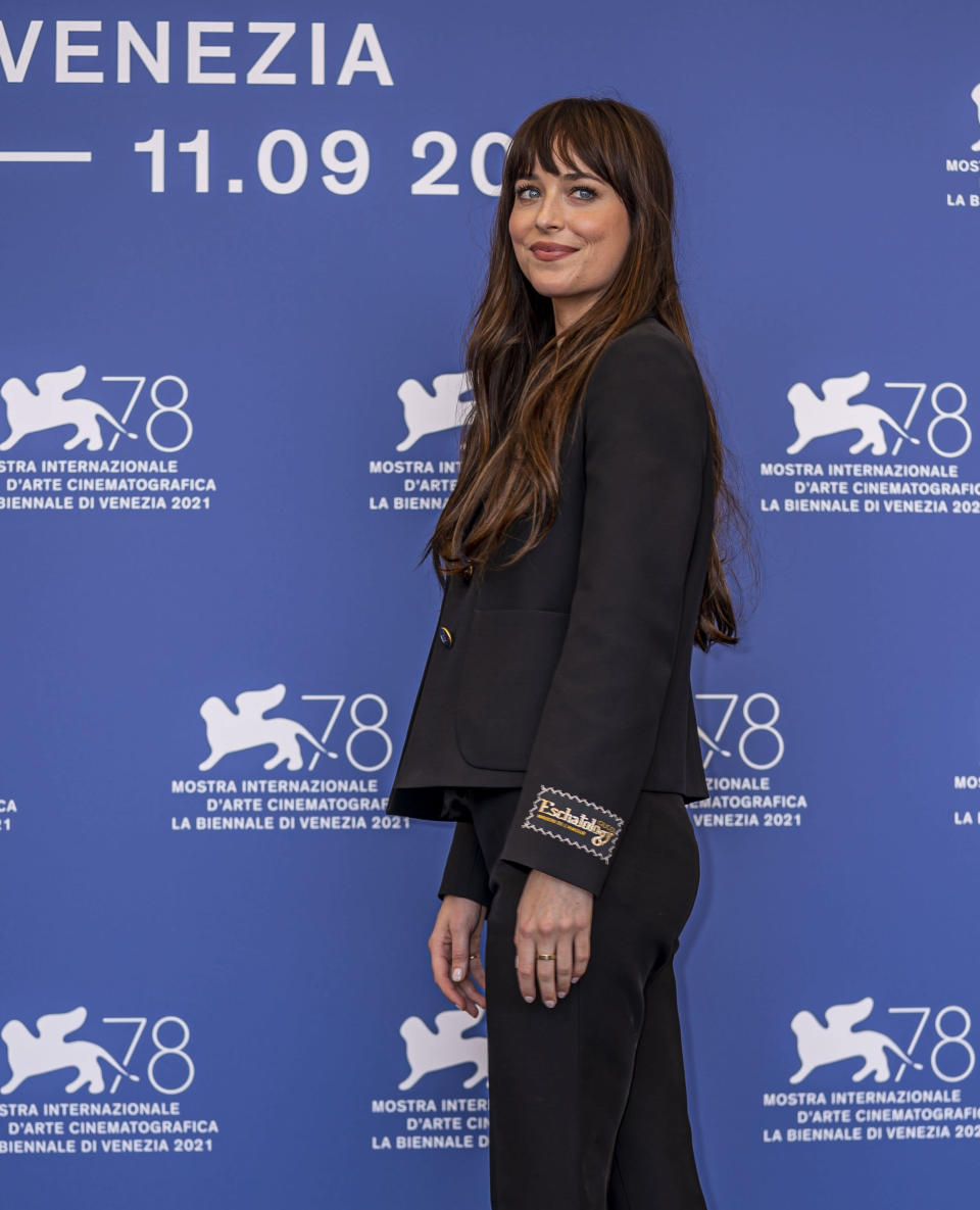 Dakota Johnson poses for photographers at the photo call for the film 'The Lost Daughter' during the 78th edition of the Venice Film Festival in Venice, Italy, Friday, Sep, 3, 2021. (AP Photo/Domenico Stinellis)