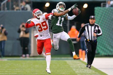 Dec 3, 2017; East Rutherford, NJ, USA; New York Jets wide receiver Robby Anderson (11) catches a pass against Kansas City Chiefs corner back Terrance Mitchell (39) during the third quarter at MetLife Stadium. Mandatory Credit: Brad Penner-USA TODAY Sports