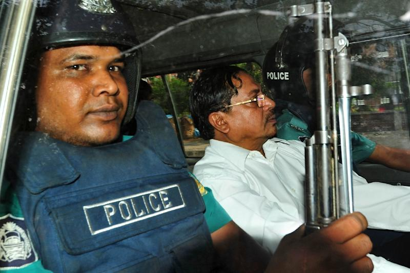 File photo of Bangladeshi Jamaat-e-Islami leader, Mohammad Kamaruzzaman, being escorted by police after appearance at a court in Dhaka, in 2013 (AFP Photo/Str)