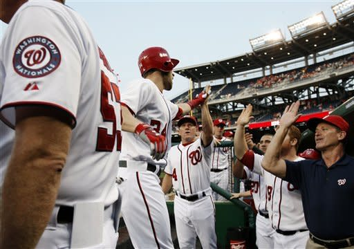 Washington Nationals' Bryce Harper, center, celebrates his two-run home run with teammates during the first inning of a baseball game against the St. Louis Cardinals, Thursday, Aug. 30, 2012, in Washington. (AP Photo/Alex Brandon)