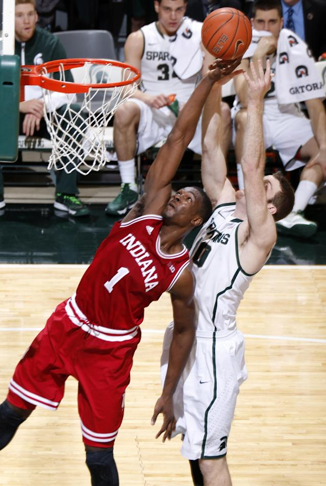 Indiana's Noah Vonleh (1) and Michigan State's Matt Costello reach for a rebound during the first half of an NCAA college basketball game, Tuesday, Jan. 21, 2014, in East Lansing, Mich. (AP Photo/Al Goldis)