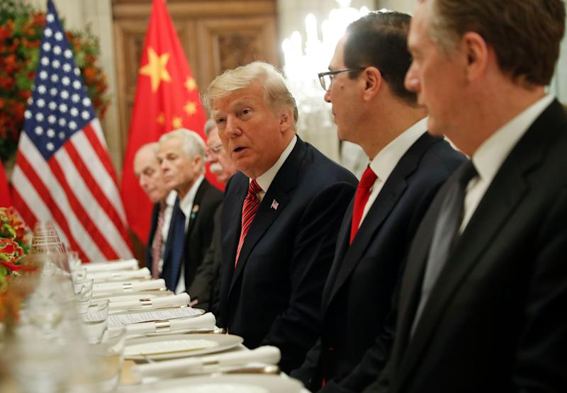 President Donald Trump, center, and members of his delegation during a bilateral meeting with China's President Xi Jinping at the G20 Summit, Saturday, Dec. 1, 2018 in Buenos Aires, Argentina. (AP Photo/Pablo Martinez Monsivais)