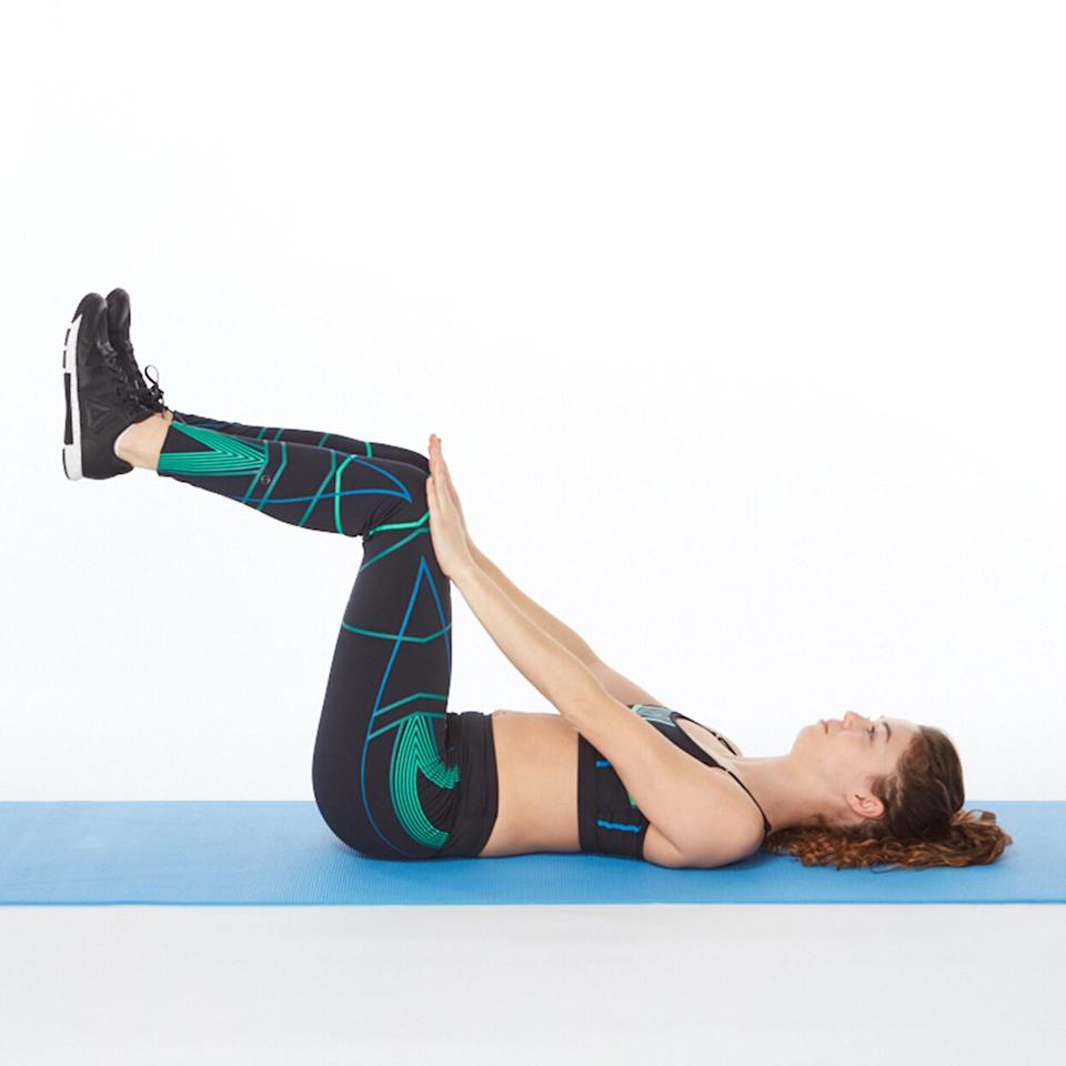 "<p>This lower-abs exercise is a great way to wake up your core at the beginning of your workout or as a stand-alone exercise any time you want to squeeze in some extra ab work. </p> <p><strong>How to do it:</strong> Lie faceup with knees and hips bent 90 degrees, feet flexed. Extend arms and press both palms on top of thighs. Take a deep breath in, and as you exhale, brace abs in tight, pressing lower back against the floor as you push thighs into hands, pushing back against them (note: your legs should not move). Hold for 1 count and then release. Do up to 3 sets of 10 repetitions in a row.</p> <p><strong>Make it harder:</strong> As you exhale, lift your head and shoulders off the floor as you press thighs and palms together. Lower upper body back down to the floor as you inhale.</p> <p><strong>Mind your muscle tip:</strong> During the contraction, imagine you are ""zipping"" your muscles from your pelvic floor up to your belly button (drawing them in tight as if trying to squeeze into a pair of <a href=""https://www.shape.com/lifestyle/fashion/good-american-invented-size-15-jeans"" target=""_blank"">low-rise jeans</a>).</p>"