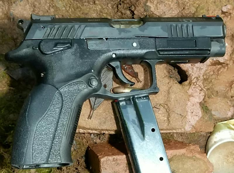 The recovered weapon used in the shooting, a 9mm Luger pistol