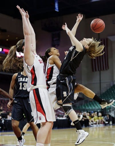 Idaho's Krissy Karr, right, is fouled as she shoots against Seattle's Kacie Sowell, left, and Daidra Brown, center, in the first half of their NCAA college basketball game in the Western Athletic Conference tournament championship, Saturday, March 16, 2013, in Las Vegas. (AP Photo/Julie Jacobson)