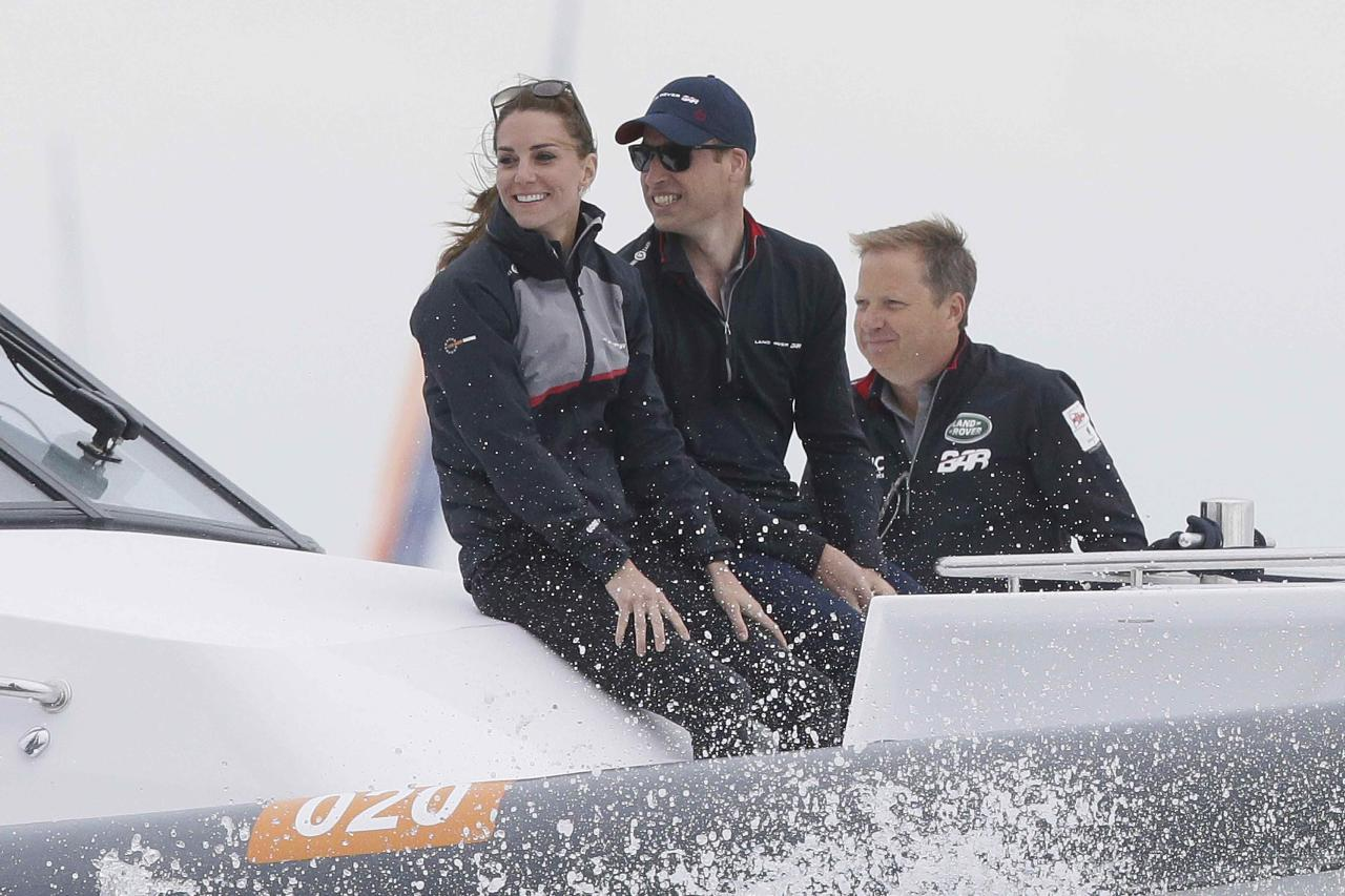 Britain's Kate, Duchess of Cambridge and Prince William ride in the front of a boat as they watch the America's Cup World Series Race, on the Solent, in Portsmouth, Britain July 24, 2016. REUTERS/Tim Ireland/Pool
