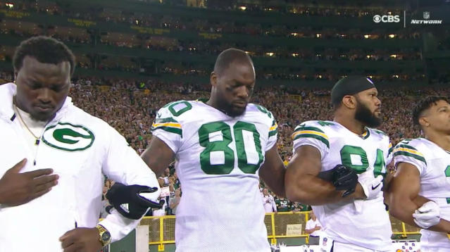 The NFL's show of solidarity in response to President Donald Trump's criticism of protests against racial injustice continued Thursday night as members of the Chicago Bears and the Green Bay Packers linked arms on the sidelines during the national anthem.