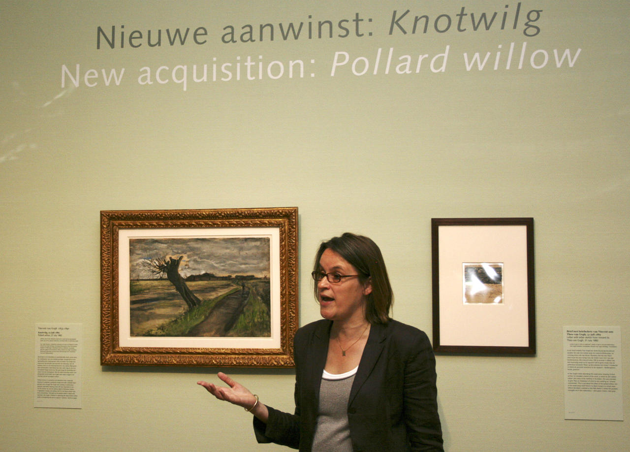 Marije Vellekoop, the museum's curator of prints and drawings, speaks near an 1882 water color of a pollard willow by Vincent van Gogh at the Van Gogh Museum in Amsterdam, Netherlands, Thursday May 10, 2012. The Van Gogh Museum unveiled the painting Thursday, the first addition in five years to its world-famous collection of works by the post-impressionist. (AP Photo/Mike Corder)