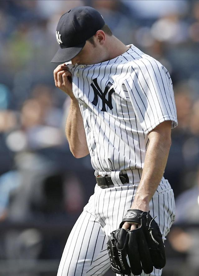 New York Yankees relief pitcher David Robertson walk off the mound after he allowed a go-ahead RBI single to Toronto Blue Jays' Dioner Navarro in the ninth inning of a baseball game at Yankee Stadium in New York, Sunday, July 27, 2014. The Blue Jays defeated the Yankees 5-4. (AP Photo/Kathy Willens)