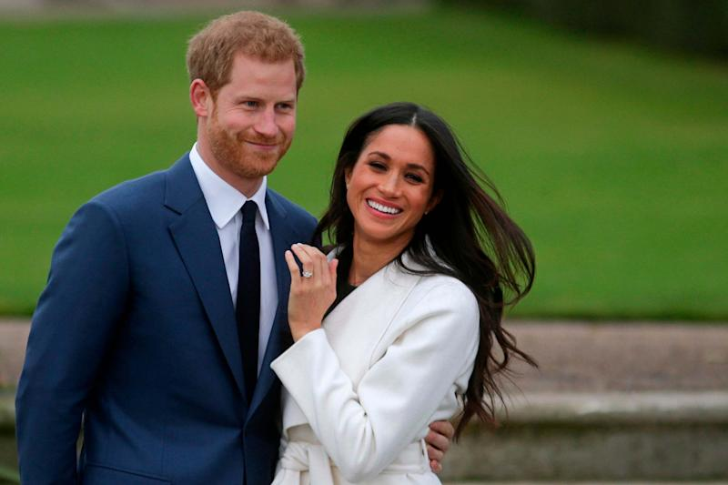 Prince Harry and Meghan Markle announcing their engagement in 2017 (AFP via Getty Images)