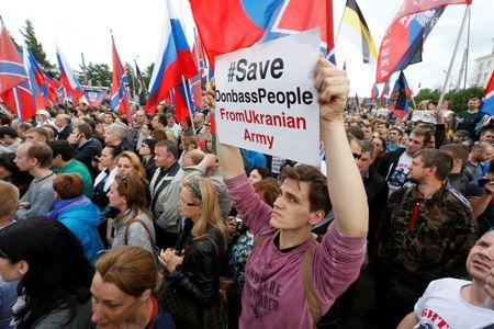 Participants attend rally supporting the pro-Russian people living in Ukraine's eastern regions, and the self-proclaimed People's Republics of Donbass and Luhansk, in Moscow