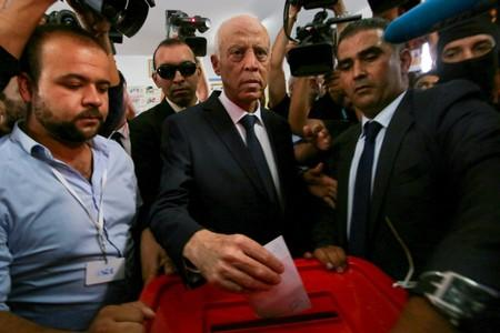 Tunisian presidential candidate Kais Saied casts his vote at a polling station