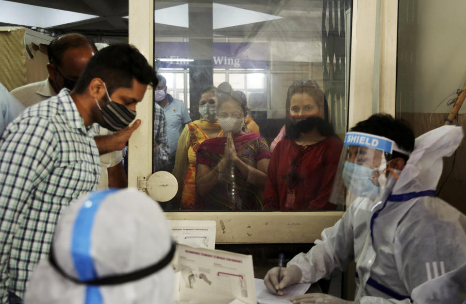 Employees of a university wait to register their names for COVID-19 test in Jammu, India, Monday, Sept. 7, 2020. India's coronavirus cases are now the second-highest in the world and only behind the United States, as the caseload crosses Brazil on a day when urban metro trains partially resume service in the capital New Delhi and other states. (AP Photo/Channi Anand)