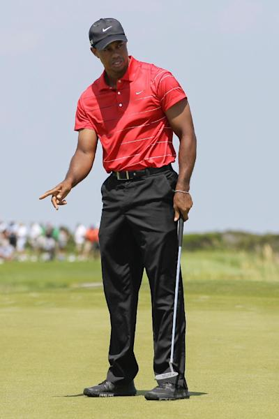 Tiger Woods watch his putt on the fifth green during the final round of the PGA Championship golf tournament on the Ocean Course of the Kiawah Island Golf Resort in Kiawah Island, S.C., Sunday, Aug. 12, 2012. (AP Photo/John Raoux)