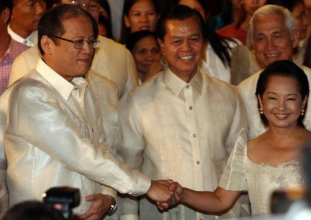 "President-Elect Benigno ""Noynoy Aquino III (left) during the traditional ""sunduan"" or fetching by the new president of outgoing President Gloria Macapagal-Arroyo (right) at the Malacanan Palace, in Manila, Philippines, 30 June 2010. Aquino and Arroyo will share a ride towards Quirino Grandstand where Arroyo will bow out as President and President Elect Aquino will take his oath as the 15th President of the Republic of the Philippines. (Mike Alquinto/NPPA Images)"