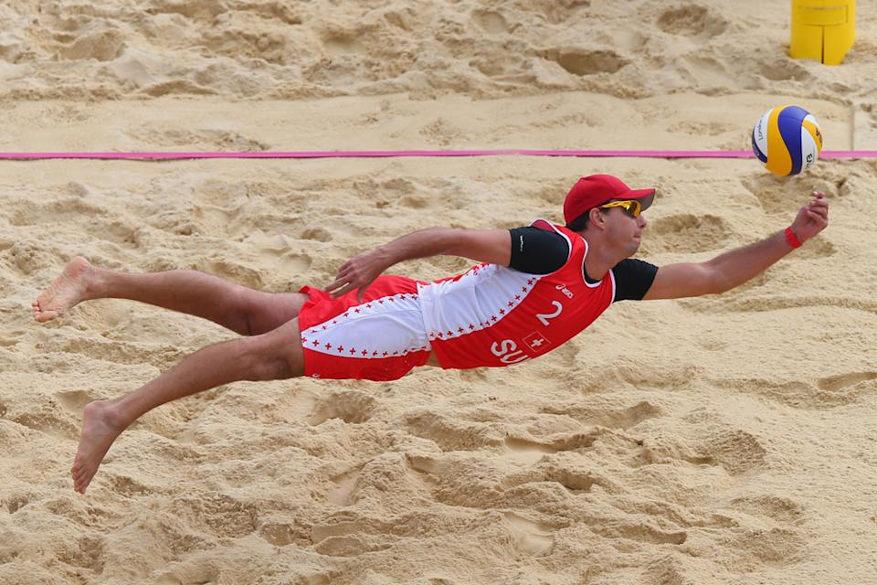 Jefferson Bellaguarda of Switzerland dives for a shot during the Men's Beach Volleyball Preliminary match between Brazil and Switzerland on Day 4 at Horse Guards Parade on July 31, 2012 in London, England. (Photo by Ryan Pierse/Getty Images)