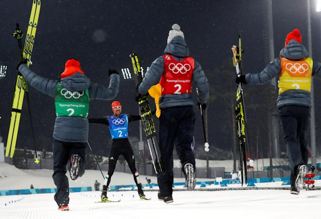 Nordic Combined Events - Pyeongchang 2018 Winter Olympics - Men's Team 4 x 5 km Final - Alpensia Cross-Country Skiing Centre - Pyeongchang, South Korea - February 22, 2018 - Johannes Rydzek of Germany celebrates with teammates Vinzenz Geiger, Fabian Riessle and Eric Frenzel after winning. REUTERS/Kai Pfaffenbach TPX IMAGES OF THE DAY