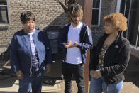 Doris Rolark, left, talks with her great-grandchildren, Tre Calhoun, 18, and Amaya Gates, right, 21, Sunday, March 7, 2021, in Monroe, Ohio. The pandemic and its isolating restrictions have been especially tough for many of the nation's some 70 million grandparents, many at ages when they are considered most vulnerable to the deadly COVID-19 virus. Rolark, of Middletown, Ohio, has always been active with the offspring. She raised three children mostly on her own, had five grandchildren (two now deceased), and has helped a lot with some of her 16 great-grandchildren. (AP Photo/Dan Sewell)